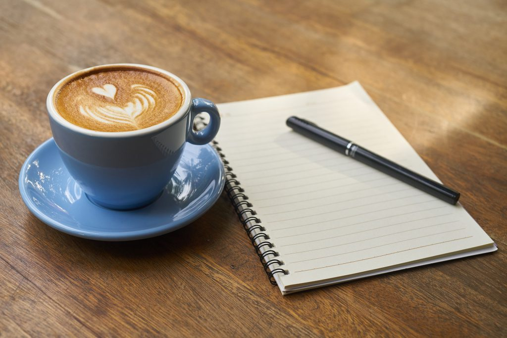 Latte Art with blue Cup and Notebook